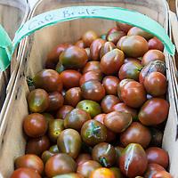 "A basket of 'Café Brulé"" heirloom tomatoes"