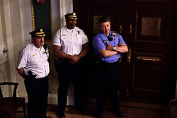 Supervisors of the Philadelphia Police department watch the ongoings from a corner of City Council Chambers as community members and activists give testimony on controversial social media posts by officers of the Philadelphia Police Department (PPD), during a council hearing on June 20, 2019 at City Hall in Philadelphia, PA.