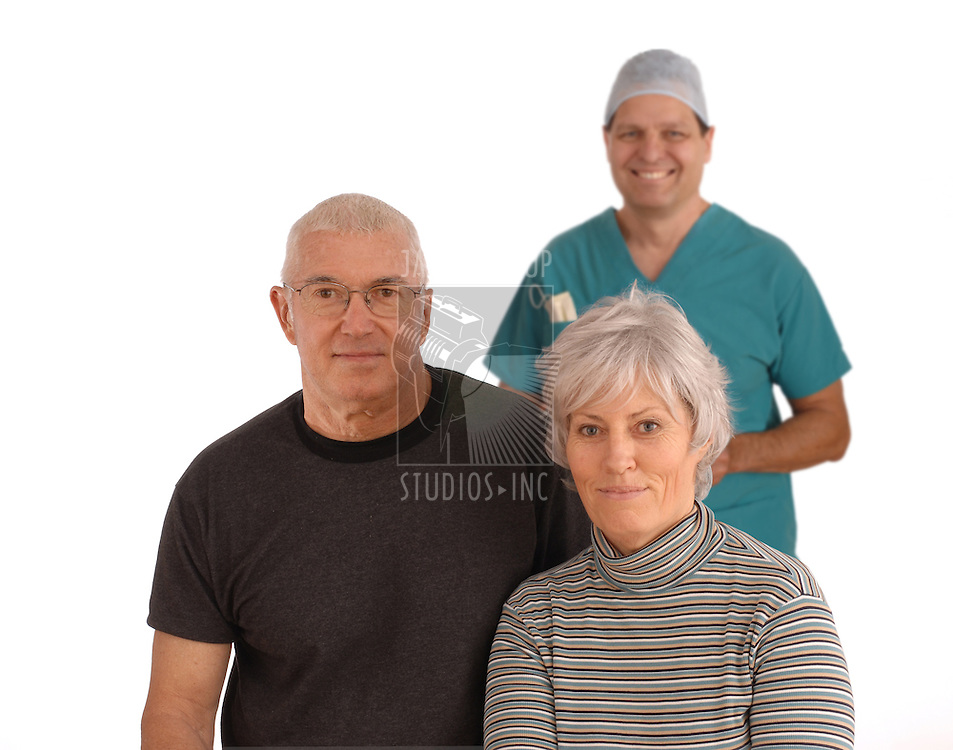 Senior couple with surgeon standing behind them on a white background