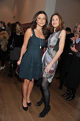 Left to right, ELLA KRASNER and KIMBERLY ORTIZ-PATINO at the launch of the Krug Happiness Exhibition at The Royal Academy, 6 Burlington Gardens, London on 12th December 2011.