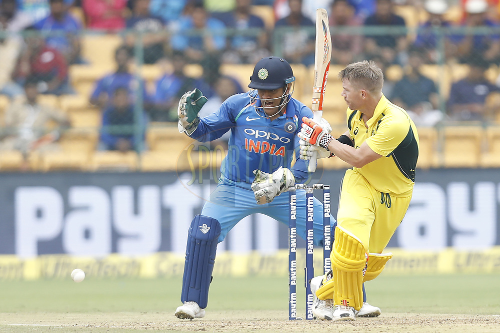 David Warner of Australia plays a shot during the 4th One Day International between India and Australia held at the M. Chinnaswamy Stadium in Bengaluru on the 28th  September 2017<br /> <br /> Photo by Arjun Singh / BCCI / SPORTZPICS
