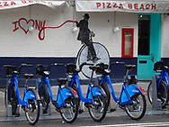 """CitiBikes and the """"I Love NY"""" mural  by Nick Walker on East 81 St and Third Ave."""