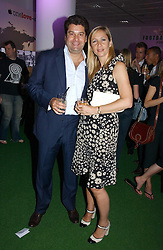 TANIA BRYER and her husband TIM MOUFFARIGE at a party to launch Umbro Football Fever at Selfridges, Oxford Street, London on 8th June 2006.<br /><br />NON EXCLUSIVE - WORLD RIGHTS