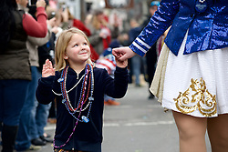 Lilly waves goodby as the parade marches on.