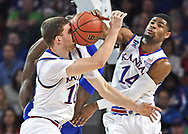 Kansas Jayhawks guard Sviatoslav Mykhailiuk (10) and guard Malik Newman (14) battle for the ball in the second half against Seton Hall in the second round of the 2018 NCAA Tournament at INTRUST Bank Arena.