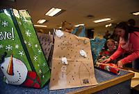 Pleasant Street School shopping for presents.  Karen Bobotas for the Laconia Daily Sun