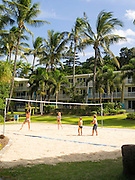 Children play volleyball at Daydream Island Resort; Whitsunday Islands, QLD, Australia