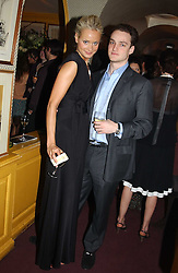 KALITA AL-SWAIDI and JAMES MAIZELS at a private dinner and presentation of Issa's Autumn-Winter 2005-2006 collection held at Annabel's, 44 Berkeley Square, London on 15th March 2005.<br />