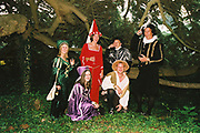 Group in historical fancy dress costumes posing amongst the trees in the garden, Posh at Addington Palace, UK, August, 2004