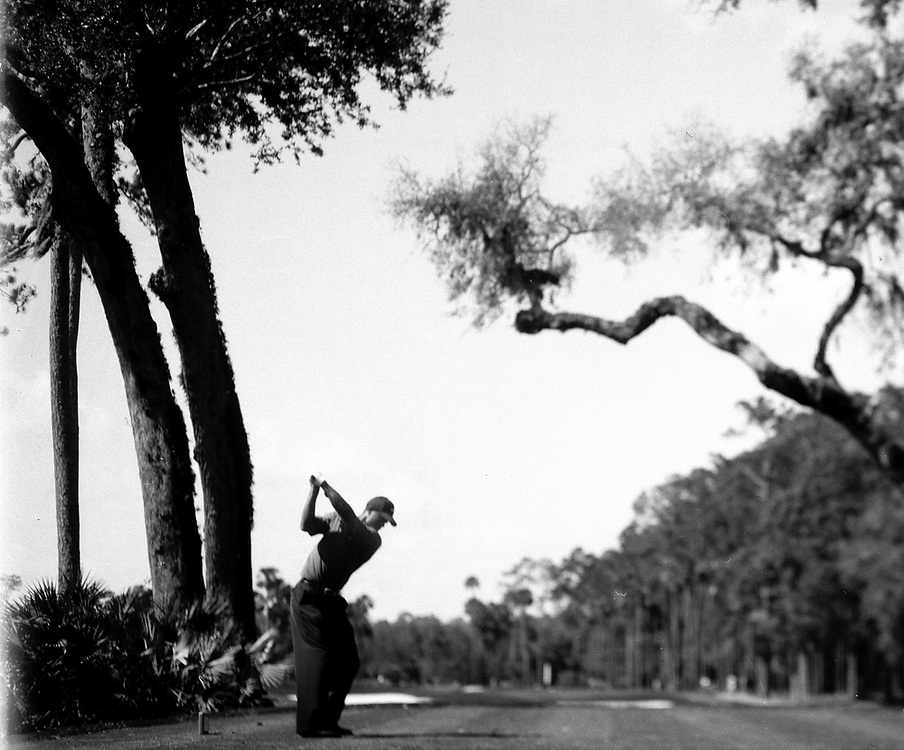 PONTE VEDRA, FLORIDA - MARCH 2005<br /> Tiger Woods tees off on the 6th hole during the 2005 Tournament Players Championship held at Sawgrass in Ponte Vedra, Florida.