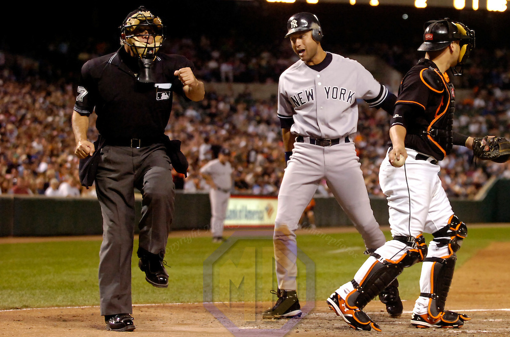 28 September 2007:  New York Yankees shortstop Derek Jeter (C) argues with home plate umpire Larry Vanover (L) after being called out on strikes in the 5th inning against Baltimore Orioles pitcher Jon Leicester.  The Orioles defeated the Yankees 10-9 in ten innings at Camden Yards in Baltimore, MD.