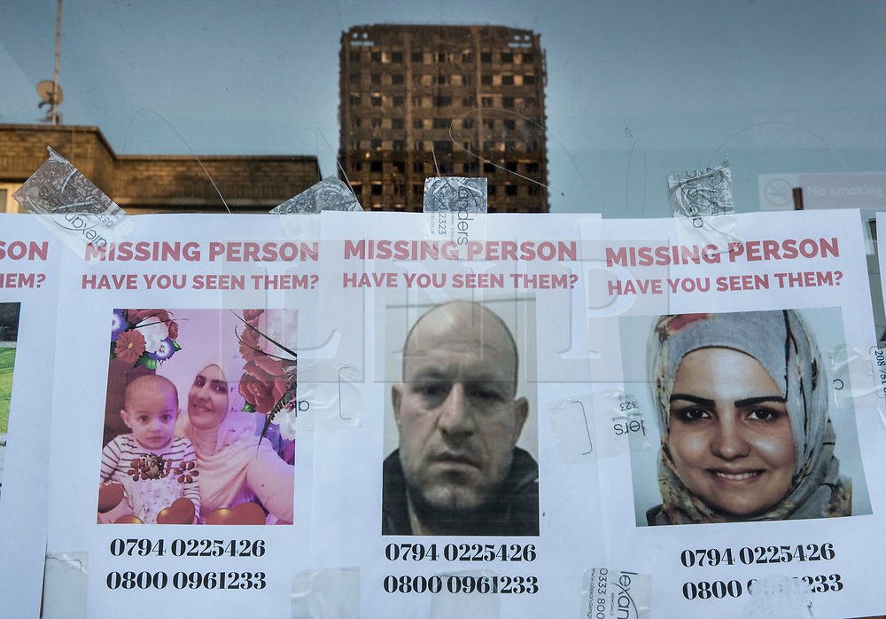 © Licensed to London News Pictures. 16/06/2017. London, UK. Missing persons poster are stuck to a bus stop that reflects the burnt remains of Grenfell Tower. The blaze engulfed the 27-storey building in the early hours of June 13th. Police say 30 people have been killed with 34 still in hospital, 18 of whom are in critical condition. The fire brigade say that they don't expect to find anyone else alive. Photo credit: Peter Macdiarmid/LNP