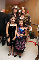 Musician JUSTIN HAWKINS and SUE WHITEHOUSE with her children left, FLORENCE and right CHARLOTTE at the English National Ballet's Mad Hatters Tea Party at St.Martins Lane Hotel, St Martins Lane, London on 12th December 2006.<br />