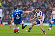Portsmouth Defender, Christian Burgess (6) tackles Rotherham United Midfielder, Jon Taylor (11) during the EFL Sky Bet League 1 match between Portsmouth and Rotherham United at Fratton Park, Portsmouth, England on 3 September 2017. Photo by Adam Rivers.