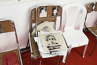 TUNIS, TUNISIA - 25 JULY 2013: A stencil of a sylized portrait of Ilyes Nader Ben Mohamed, a resident of Kram who killed at the age of 35 years on January 13th 2011, during an uprise in Kram, in the headquarter of the Men for the Protection of the Revolution, in a former RCD headquarter in Tunis, Tunisia, on July 25th 2013.<br /> <br /> Tunisia, birthplace of the Arab Spring revolutionary movement, was plunged into a new political crisis on Thursday when assassins shot Mohamed Brahmi, 58, leader of the Arab nationalist People's Party, an opposition party leader outside his home in a hail of gunfire.