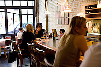 8 October, 2008. New York, NY. Customers have lunch at the bar of the Veritas Restaurant  in the Flatiron district, NYC.<br /> <br /> ©2008 Gianni Cipriano for The New York Times<br /> cell. +1 646 465 2168 (USA)<br /> cell. +1 328 567 7923 (Italy)<br /> gianni@giannicipriano.com<br /> www.giannicipriano.com