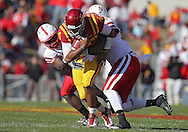 November 06 2010: Iowa State Cyclones quarterback Austen Arnaud (4) is hit by Nebraska Cornhuskers defensive back DeJon Gomes (7) and Nebraska Cornhuskers defensive end Pierre Allen (95) during the first half of the NCAA football game between the Nebraska Cornhuskers and the Iowa State Cyclones at Jack Trice Stadium in Ames, Iowa on Saturday November 6, 2010. Nebraska defeated Iowa State 31-30.