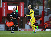 Nottingham Forest defender Matt Mills looking to the ref for a penalty  during the Sky Bet Championship match between Brentford and Nottingham Forest at Griffin Park, London, England on 21 November 2015. Photo by Matthew Redman.