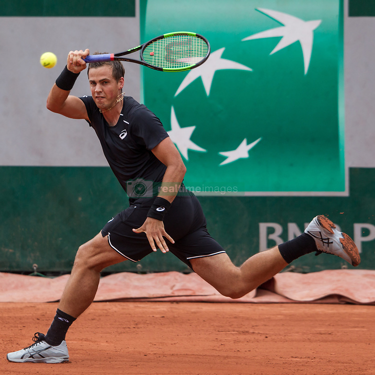 May 29, 2018 - Paris, France - Vasek Pospisil of Canada returns the ball to Márton Fucsovics of Hungary during the first round at Roland Garros Grand Slam Tournament - Day 3 on May 29, 2018 in Paris, France. (Credit Image: © Robert Szaniszlo/NurPhoto via ZUMA Press)
