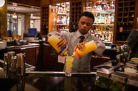 Memphis, Tennessee- November 4, 2014: A bartender mixes Peabody Punch for guests who have gathered to watch the daily march of the ducks. CREDIT: Chris Carmichael for The New York Times