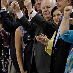 April 19, 2012; New Orleans, LA, USA; New Orleans Hornets and Saints owner Tom Benson and his wife Gayle Benson cheer courtside during an overtime win against the Houston Rockets at the New Orleans Arena. The Hornets defeated the Rockets 105-99.   Mandatory Credit: Derick E. Hingle-US PRESSWIRE