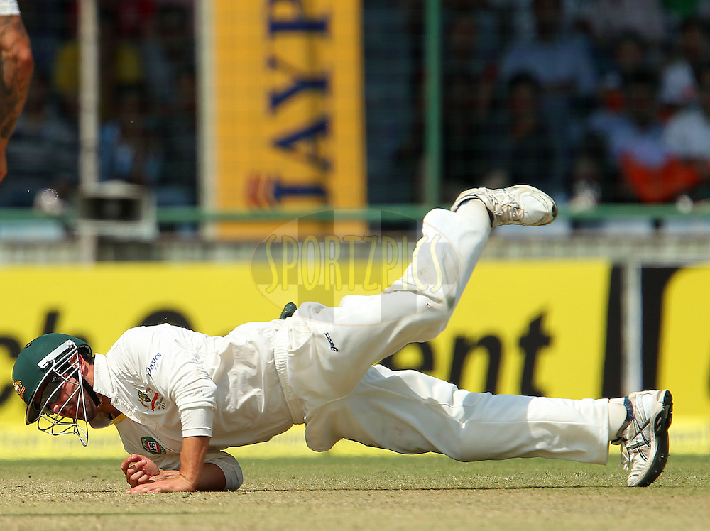 Ed Cowan of Australia dives to stop the ball during day 2 of the 4th Test Match between India and Australia held at the Feroz Shah Kotla stadium in Delhi on the 23rd March 2013..Photo by Ron Gaunt/BCCI/SPORTZPICS ..Use of this image is subject to the terms and conditions as outlined by the BCCI. These terms can be found by following this link:..http://www.sportzpics.co.za/image/I0000SoRagM2cIEc