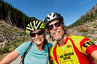BC00638-00...MONTANA - Vicky Spring and Tom kirkendall at the Whitefish Divide along Forest Service Road 114 section of the Great Divide Mountain Bike Route.