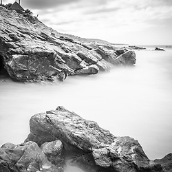 Laguna Beach California rock formations black and white picture, Laguna Beach is a beach city along the Pacific Ocean in Orange County Southern California.