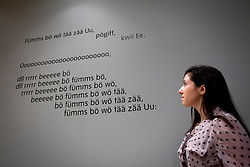 © Licensed to London News Pictures. 28/01/2013. London, UK. A Tate Britain employee views the 'Ursonate' (1944) a poem by late German artist Kurt Scwitters at the press view of an exhibition of the artists work taking place at the Tate Britain in London. The exhibition, 'Schwitters in Britain', is the first to to examine the work of the late German modernist artist's 'British period' (1940-1948), and runs from 30th of January 2013 to the 12th of May 2013. Photo credit: Matt Cetti-Roberts/LNP