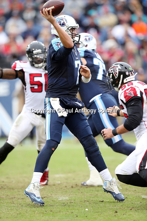 Tennessee Titans quarterback Zach Mettenberger (7) jumps off his feet and throws for a third quarter gain of 17 yards during the 2015 week 7 regular season NFL football game against the Atlanta Falcons on Sunday, Oct. 25, 2015 in Nashville, Tenn. The Falcons won the game 10-7. (©Paul Anthony Spinelli)