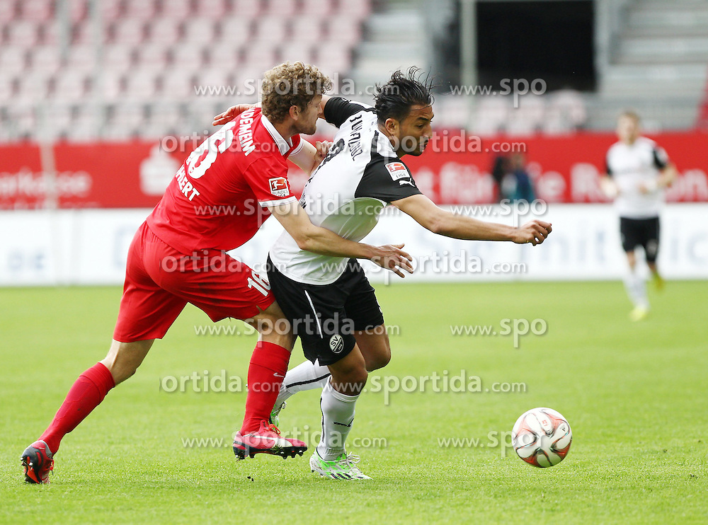 03.05.2015, Hardtwald, Sandhausen, GER, 2. FBL, SV Sandhausen vs 1. FC Heidenheim, 31. Runde, im Bild Tim Goehlert (1.FC Heidenheim 1846 e.V.) im Zweikampf mit Aziz Bouhaddouz (SV Sandhausen) // during the 2nd German Bundesliga 31th round match between SV Sandhausen and 1. FC Heidenheim at the Hardtwald in Sandhausen, Germany on 2015/05/03. EXPA Pictures &copy; 2015, PhotoCredit: EXPA/ Eibner-Pressefoto/ Bermel<br /> <br /> *****ATTENTION - OUT of GER*****