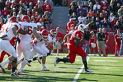 15 October 2011: Ashton Leggett makes his way through the line and into the secondary during an NCAA football game between the University of South Dakota Coyotes and the Illinois State Redbirds (ISU) at Hancock Stadium in Normal Illinois.
