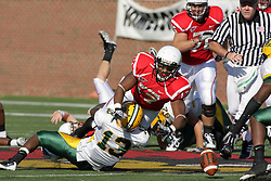 16 October 2010:  Brandon Venson loses control of the ball when hit by Freddie Banks during a game where the North Dakota State Bison lost to the Illinois State Redbirds 34-24, meeting at Hancock Stadium on the campus of Illinois State University in Normal Illinois.