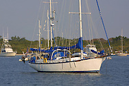 A ferrocement sailboat, Chez Nous, at anchor at Desoto Point in Tampa Bay.