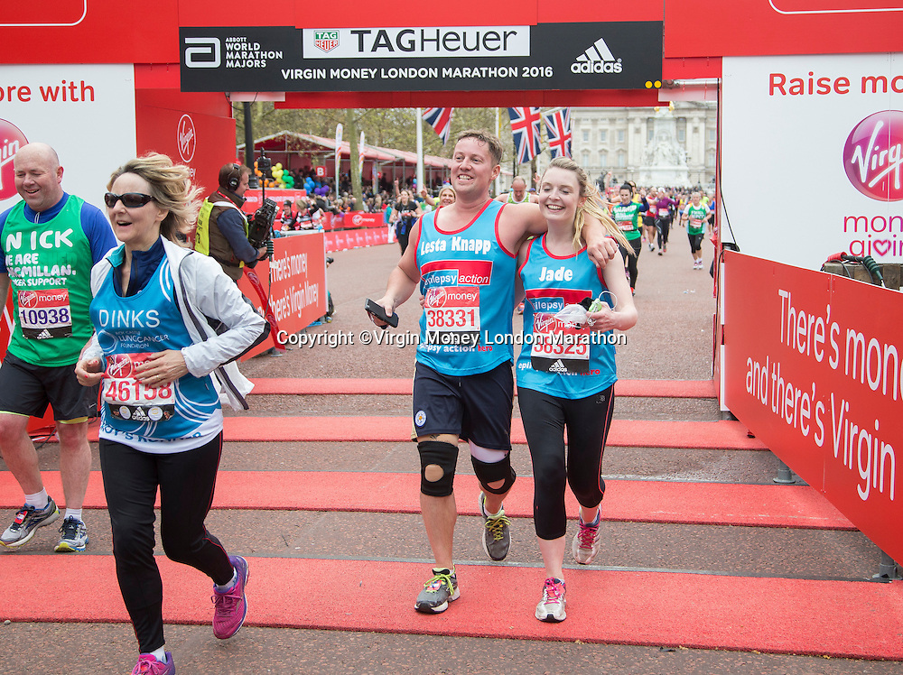 Athletes react after crossing the finish line. The Virgin Money London Marathon, Sunday 24th April 2016.<br /> <br /> Photo: Jed Leicester for Virgin Money London Marathon<br /> <br /> For more information please contact media@londonmarathonevents.co.uk