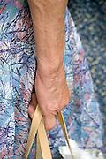 elderly woman holding a bag