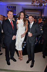 Left to right, Peter Phillips, model Courtney Sixx and Australian jockey Hugh Bowman at the 4th Longines World's Best Racehorse Ceremony, Claridge's, Brook Street, London England. 24 January 2017.