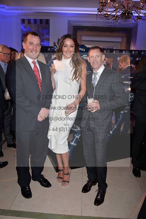 Left to right, Peter Phillips, model Courtney Sixx and Australian jockey Hugh Bowman at the 4th Longines World's Best Racehorse Ceremony, Claridge's, Brook Street, London England. 24 January 2017.