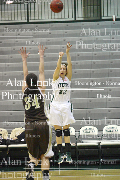 17 December 2011:  Michelle Bilek shoots from just inside the line over defender Ashley Teresiak during an NCAA womens division 3 basketball game between the St. Francis Fighting Saints and the Illinois Wesleyan Titans in Shirk Center, Bloomington IL