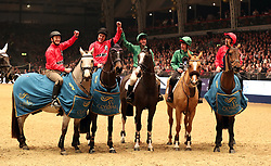 Jump and Flat racing jockeys, including Frankie Dettori and Sir Anthony McCoy after competing in the Markel Champions Challenge in aid of the Injured Jockeys Fund during day four of the London International Horse Show at London Olympia.
