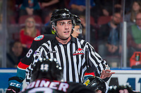 KELOWNA, CANADA - OCTOBER 20: Linesman Tim Plamondon stands at centre ice between the Kelowna Rockets and the Portland Winterhawks on October 20, 2017 at Prospera Place in Kelowna, British Columbia, Canada.  (Photo by Marissa Baecker/Shoot the Breeze)  *** Local Caption ***