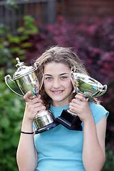 12 year old girl with sports trophy UK