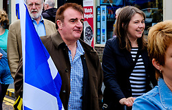 Lanark, Scotland, UK 20th August 2016   A march and ceremony to commemorate the death of Scottish Hero William Wallace (23rd August 1302) held on Saturday 20th August 2016.  Wallace has strong connections with the town of Lanark.  Tommy Sheppard MP in the parade with Aileen Campbell MSP (R).<br /> <br /> (c) Andrew Wilson | Edinburgh Elite media