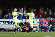 Peterborough United striker Marcus Maddison (11) AFC Wimbledon defender Toby Sibbick (35) and Peterborough United striker Tom Nichols (21) during the EFL Sky Bet League 1 match between AFC Wimbledon and Peterborough United at the Cherry Red Records Stadium, Kingston, England on 17 April 2017. Photo by Stuart Butcher.