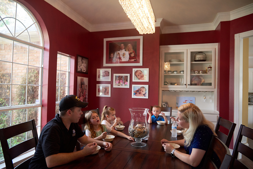 Paul and Brenda Chabot eat ice cream for their four children at their new home in McKinney, Texas on August 13, 2017. (Cooper Neill for The New York Times)