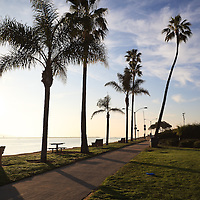 Photo of West Jetty View Park in Newport Beach California. West Jetty View Park is located at Peninsula Point at the end of Balboa Peninsula where Newport Bay meets the Pacific Ocean. Newport Beach is a beach community along the Pacific Ocean in Orange County Southern California.