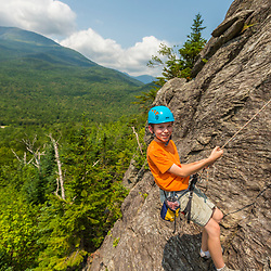 Will Tuttle rappelling down Square Ledge in New Hampshire's White Mountains.