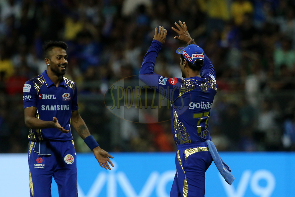 Surya Kumar Yadav of the Mumbai Indians and Hardik Pandya of the Mumbai Indians celebrates the wicket of Chennai Superkings of Ravindra Jadeja of the Chennai Superkings during match one of the Vivo Indian Premier League 2018 (IPL 2018) between the Mumbai Indians and the Chennai Super Kings held at the Wankhede Stadium in Mumbai on the 7th April 2018.<br /> <br /> Photo by Vipin Pawar / IPL / SPORTZPICS