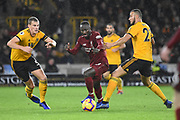 Liverpool midfielder Naby Keita (8) takes on Wolverhampton Wanderers defender Matt Doherty (2) and Wolverhampton Wanderers defender Ryan Bennett (5) during the Premier League match between Wolverhampton Wanderers and Liverpool at Molineux, Wolverhampton, England on 21 December 2018.