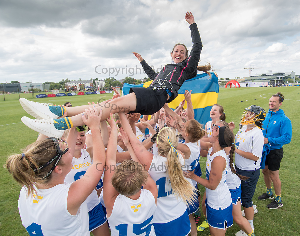 Madeleine Munter, Swedish alternate, feels the love of her team mates at the 2017 FIL Rathbones Women's Lacrosse World Cup at Surrey Sports Park, Guilford, Surrey, UK, 15th July 2017